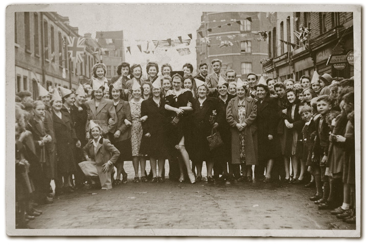 Harry Young, alias Diamond Lil, stands at the centre of photograph taken on VE Day 8 May 1945 on Columbia Road. From left kneeling; Gladys Herd, Mrs Stephens, Isabella Wilkinson, Clara Hoare, Nell Lloyd, Diamond Lil, Isabella Lloyd, Alice Wilkinson. Photograph: