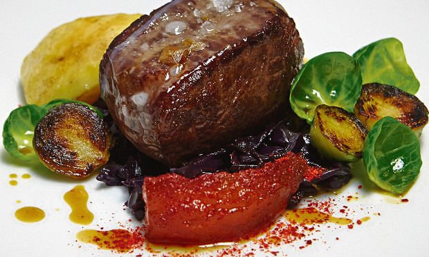 Roast loin of venison with braised red cabbage and sprout tops. Photograph: Patricia Niven