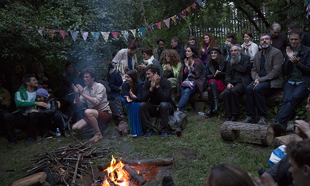 Sam Lee of the Nest Collective (left, in shorts) stokes the passions of crowds at Campfire Club