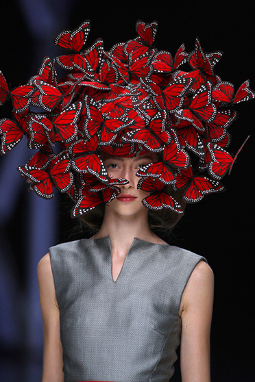 Butterfly headdress of hand-painted turkey feathers Philip Treacy for Alexander McQueen La Dame Bleu Spring Summer 2008. Copyright: Anthea Sims