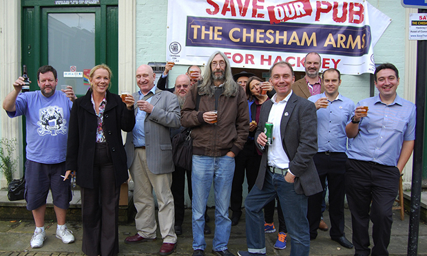 Mine's a pint: Victorious Chesham Arms campaigners. Photograph: Save the Chesham