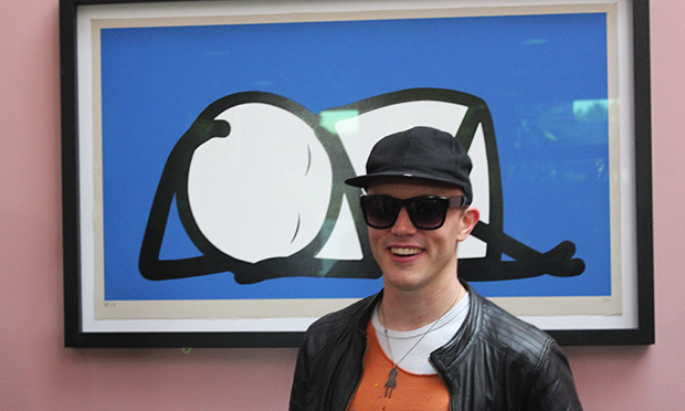 Stik infront of a print of Sleeping Baby. Photograph: Russell Parton