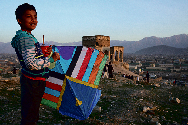 Andrew Quilty - Oculi –Kites from Kabul – V&A Museum of Childhood 620A young kite flier late in the afternoon on a Friday on the hill home to the tomb of Nader Khan Tomb - a popular place for kite flying - in Kabul.
