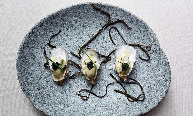 Champagne poached oyster with truffle and chive scrambled eggs